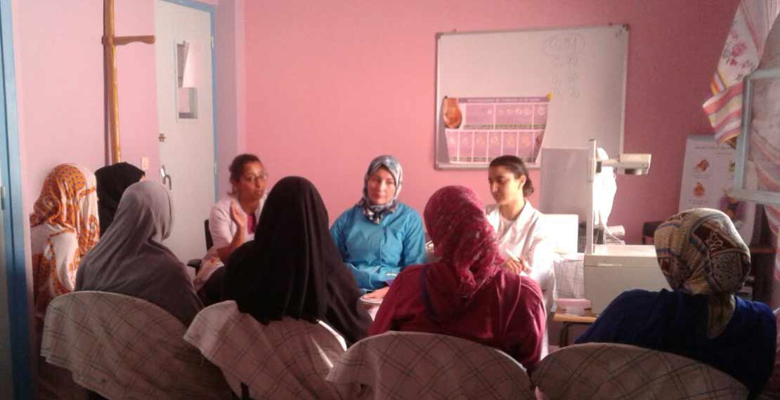 Meeting of pregnant women affected by GDM (gestational diabetes mellitus) discussing nutrition at their health centre with their midwife.