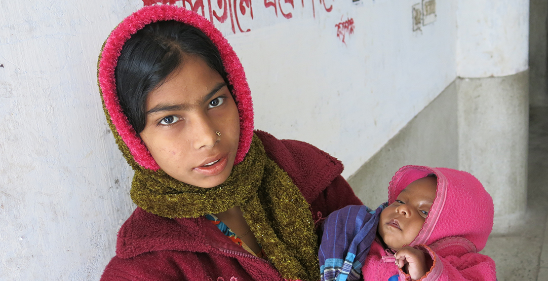 Fifteen year old mother with newborn in Bangladesh.
