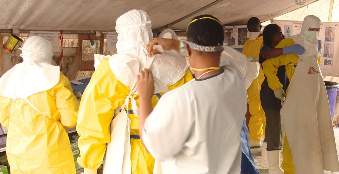 you see several peoples suiting up with hazmat suits
