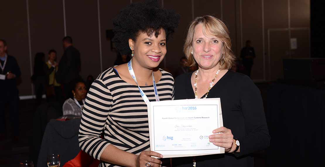 a picture is shown of Ona Ilozumba with another woman both holding the certificate