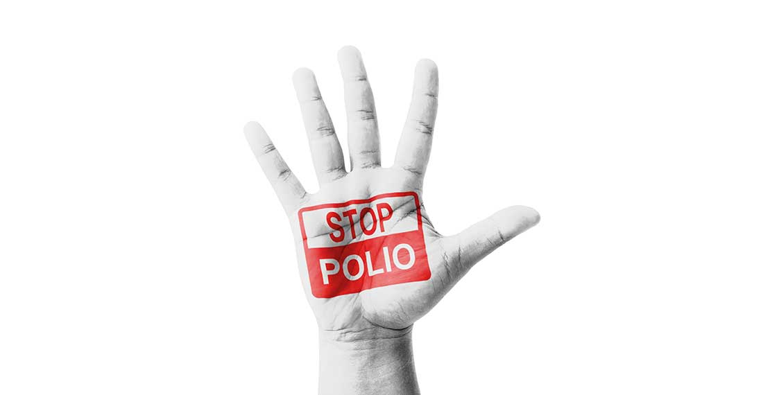 a white hand is shown with the red-white text : Stop Polio