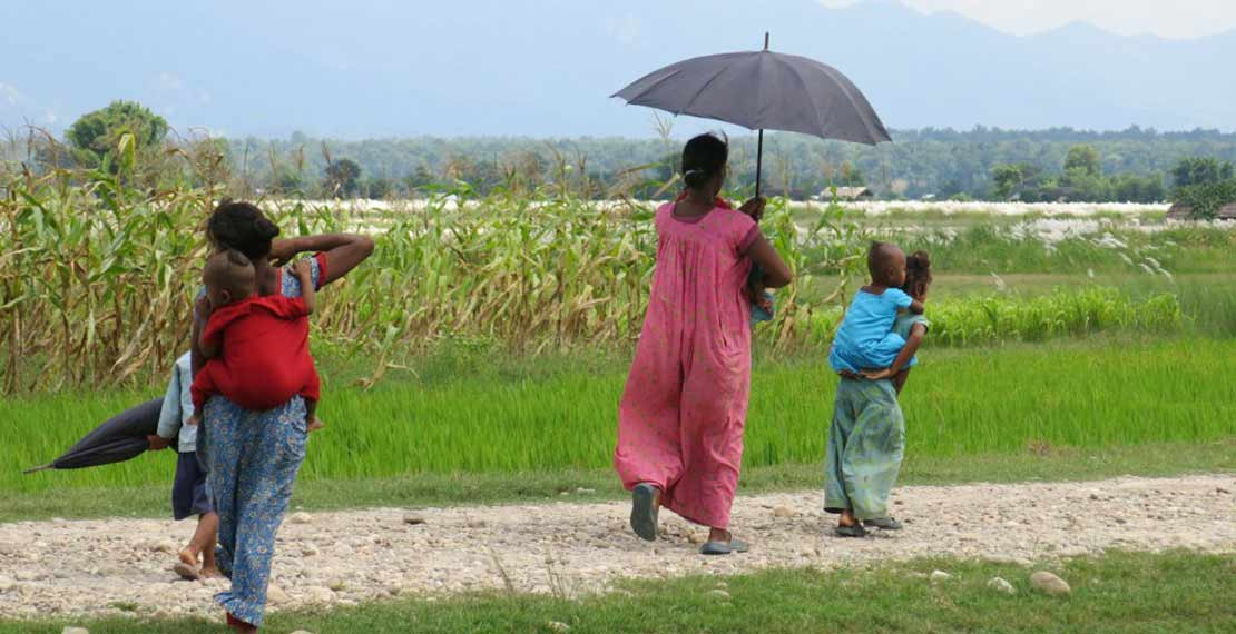 a picture is shown of a woman walking with 6 children