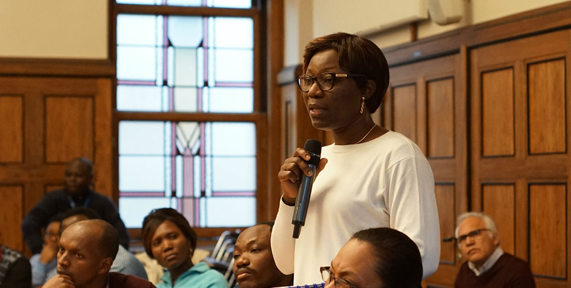 Master's student Tina Songo Tokofai from Togo asks a question.